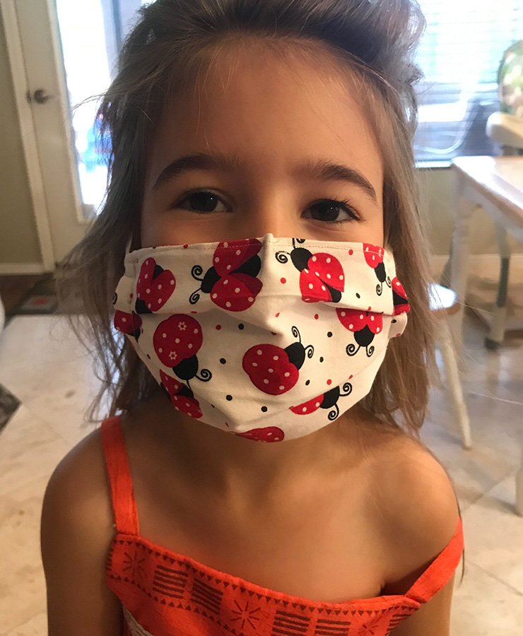 Makenna in lady bug mask